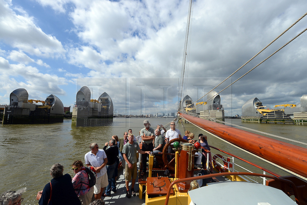 © Licensed to London News Pictures. 30/08/2013. London, UK. Morgenster, a Dutch Brig Type Tall Ship, Length 33.33 meters, at the Thames Barrier as part of boat trip for Thames Tall Ship cruises and marking one year until The Tall Ship Regatta, Falmouth to Greenwich in August 2014.. Photo credit: Mike King/LNP