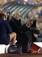 Photo. Jed Wee.<br /> Leeds United v Manchester United, Carling Cup, Elland Road, Leeds. 28/10/03.<br /> A glum faced Leeds manager Peter Reid finds something to applaud, albeit without much conviction.
