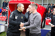 Colin Calderwood shaking hands with Graham Alexander  during the EFL Sky Bet League 2 match between Salford City and Cambridge United at Moor Lane, Salford, United Kingdom on 12 October 2019.