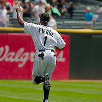 Chicago, IL - June 05, 2011:  Juan Pierre (1) waives to the crowd before the Chicago White Sox play host to the 2nd place visiting Detroit Tigers at U.S. Cellular Field on June 05, 2011 in Chicago, IL.