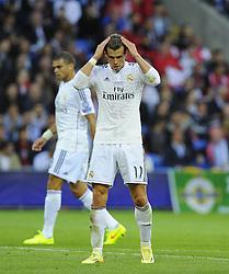 Real Madrid's Gareth Bale adjusts his hair  - Photo mandatory by-line: Joe Meredith/JMP - Mobile: 07966 386802 12/08/2014 - SPORT - FOOTBALL - Cardiff - Cardiff City Stadium - Real Madrid v Sevilla - UEFA Super Cup