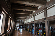 """Himeji Castle interior, built 1609, Hyogo Prefecture, Japan. Himeji Castle is both a national treasure and a UNESCO World Heritage Site. Unlike many other Japanese castles, it was never destroyed by war, earthquake or fire and survives to this day as one of the country's twelve original castles. History: Starting as forts built in 1333 and 1346, Himeji Castle (aka White Heron Castle or White Egret Castle) was remodeled in 1561, remodeled in 1581, enlarged in 1609 to its present complex, extensively repaired in 1956, and renovated in 2009-15. Displayed inside are historic samurai armour and swords. From the upper floors, view fish-shaped roof ornaments that are believed to protect from fire. Across the moat, visit Koko-en, a pleasing reconstruction of former samurai quarters, nine Edo period homes, plus movie-set gardens. Himeji Castle starred in the 1967 James Bond movie """"You Only Live Twice""""; in Akira Kurosawa's 1980 film """"Kagemusha"""" and 1985 """"Ran""""; and in the 1980 television miniseries Shogun (portraying feudal Osaka castle). By train, Himeji is 3 hours round trip from Kyoto."""