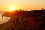 Spectators at the Wedge in Newport Beach at Sunset