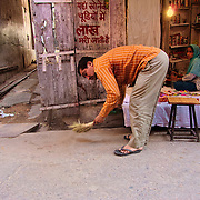 People preparing their houses for the first night of Diwali