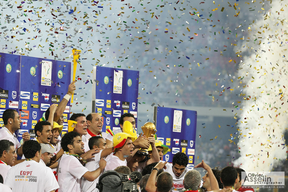 Members of the Egypt national football team celebrate after defeating Cameroon to win the 2008 Africa Cup of Nations in Accra, Ghana.
