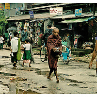 A Burmese Monk moves through the streets of Bago, the ancient capital of Burma, in a daily round to collect food and bless the people. .Many monks in their twenties are now the target of the persecution and repression of the military dictatorship in Burma. Monday October 8,2007. Bago, Myanmar (Burma)