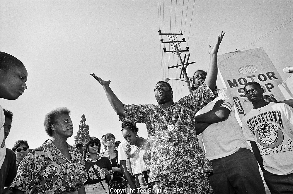 South Central LA residents gather on a street corner to ask fellow residents to stop the violence and rioting.
