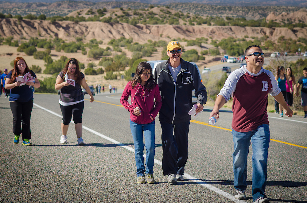 Friends and family walk together from Nambé, New Mexico to El Santuario de Chimayo, on Good Friday, April 18, 2014. As many as 40,000 pilgrims journey to El Santuario de Chimayo each year during the Easter weekend. (AP Photo/Jeremy Wade Shockley)