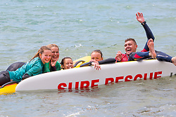 © Licensed to London News Pictures. 23/06/2018. Brighton, UK. Members of the Brighton Surf Life Saving Club have a relaxing training session in the sea in brighton and Hove as sunny and warmer weather is hitting the seaside resort. Photo credit: Hugo Michiels/LNP