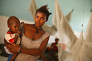 Mother and her child in the therapeutic feeding center of the Magbenthe hospital in Makeni, Sierra Leone, on Friday February 27, 2009. UNICEF sponsored some of the construction of the facilities, and also provides high-protein biscuits and milk as part of a joint effort with the World Food Programme..