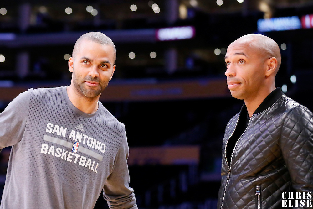 19 February 2016:  San Antonio Spurs guard Tony Parker (9) is seen next to Soccer player Thierry Henry prior to the San Antonio Spurs 119-113 victory over the Los Angeles Lakers, at the Staples Center, Los Angeles, California, USA.