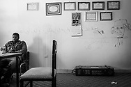 A captured soldier from Gadhafi's forces in a school room waits for an interrogation session. 12 May 2011.