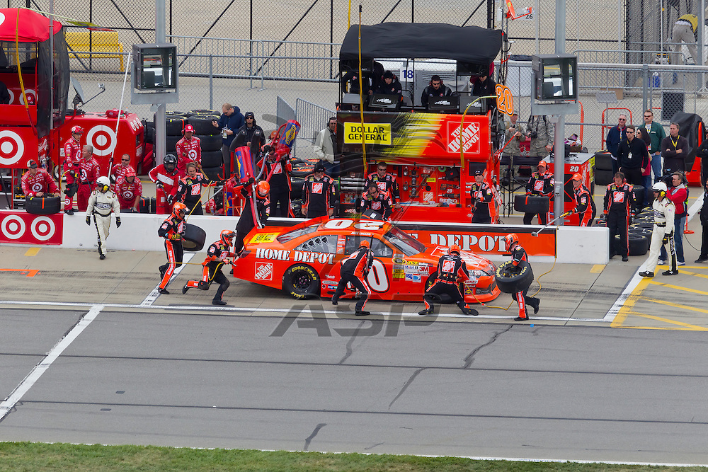 KANSAS CITY, KS - APR 22, 2012:  Joey Logano (20) races during the STP 400 at the Kansas Speedway in Kansas City, KS.