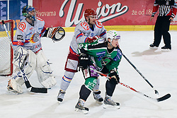 Tomi Mustonen (HDD Tilia Olimpija, #21) and Tomi Hafner (HK Acroni Jesenice, #91) during ice-hockey match between HDD Tilia Olimpija and HK Acroni Jesenice in 41st Round of EBEL league, on Januar 23, 2011 at Hala Tivoli, Ljubljana, Slovenia. (Photo By Matic Klansek Velej / Sportida.com)
