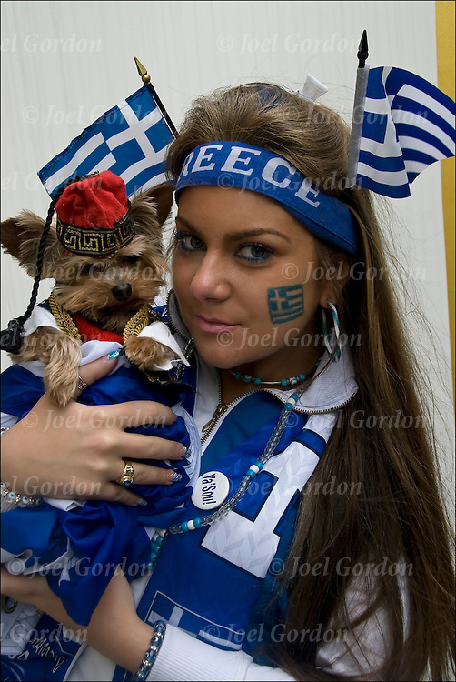 Greek American holding her dog showing her ethnic pride and heritage in the Greek Independence Day Parade in New York City.