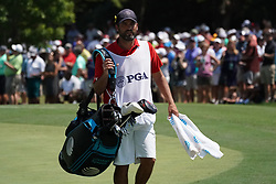 August 10, 2018 - St. Louis, Missouri, United States - Jordan Spieth's caddie, Michael Greller approaches the 9th green during the second round of the 100th PGA Championship at Bellerive Country Club. (Credit Image: © Debby Wong via ZUMA Wire)