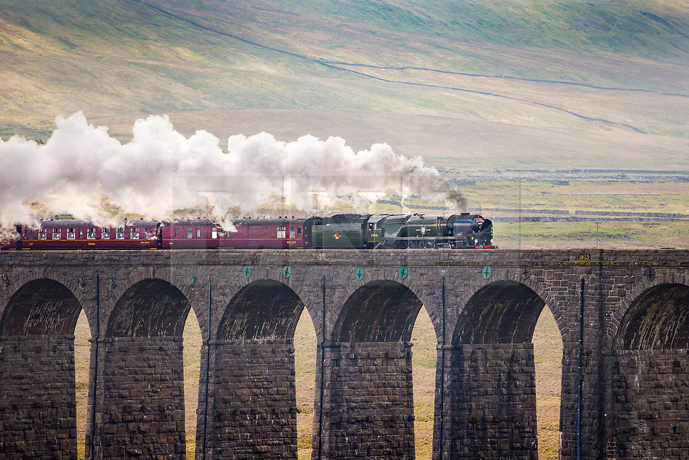 © Licensed to London News Pictures. 08/05/2018. Ribblehead UK. Locomotive 35018, a 1945 SR Merchant Navy Class British India Line steam engine pulls the Dalesman over Ribblehead Viaduct in the Yorkshire Dales this afternoon on it's way from Settle to Carlisle. Photo credit: Andrew McCaren/LNP