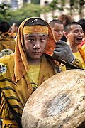 Portrait of a drummer who leads the religious parade.