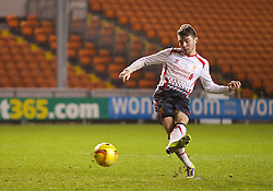 BLACKPOOL, ENGLAND - Wednesday, December 18, 2013: Liverpool's Joe Maguire scores his side's sixth penalty, the deciding fourth goal, during the shoot-out against Blackpool to make the score 4-3 during the FA Youth Cup 3rd Round match at Bloomfield Road. (Pic by David Rawcliffe/Propaganda)