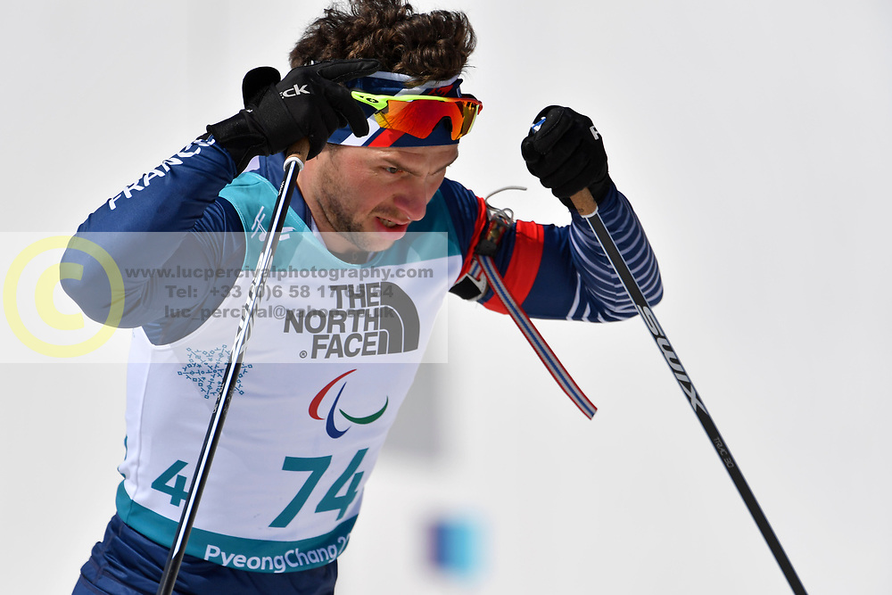DAVIET Benjamin FRA LW2 competing in the ParaBiathlon, Para Biathlon at  the PyeongChang2018 Winter Paralympic Games, South Korea.