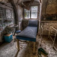Examination room in a small abandoned hospital