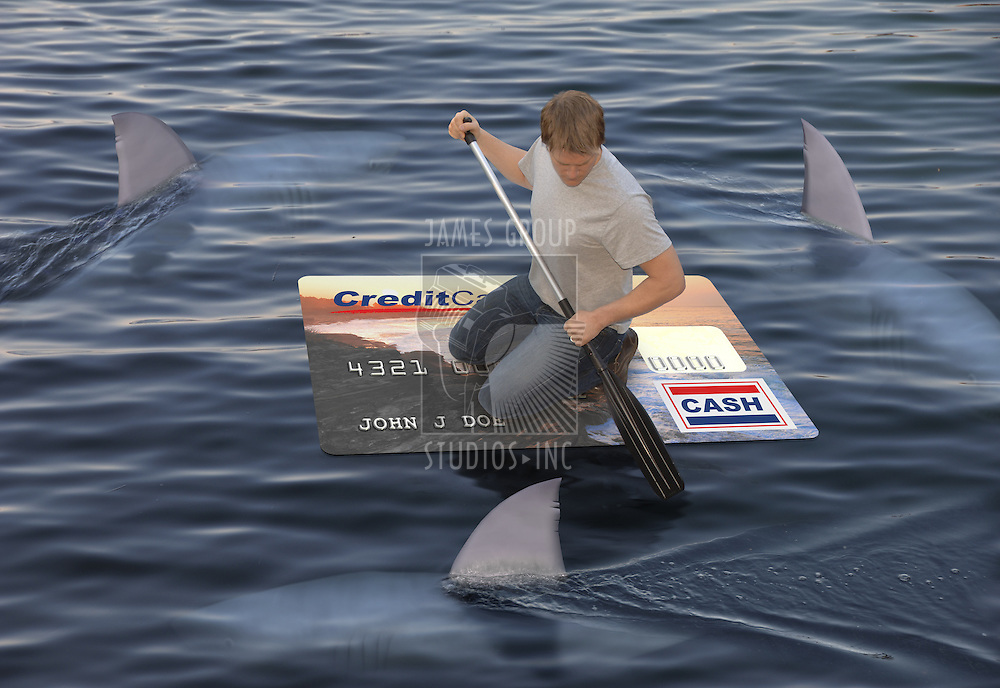 Man stranded on a raft made of a huge credit card in the ocean while being circled by sharks