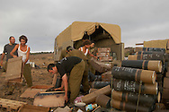 IDF artillery soldiers clearing artillery waist between firing missions. 2nd Lebanon War. Israel, August 2006.