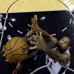 Jun 13, 2013; San Antonio, TX, USA; Miami Heat small forward LeBron James (6) shoots against San Antonio Spurs power forward Tim Duncan (21) during the first half of game four of the 2013 NBA Finals at the AT&T Center. Mandatory Credit: Derick E. Hingle-USA TODAY Sports