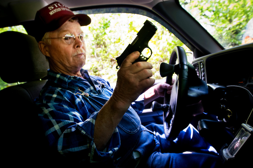 Cross country trip by Greyhound bus. ..First stop: West Virginia - mining and mountaintop removal in the Charleston area..Larry Gibson who lives on Kayford Mountain keeps a gun in his truck at all times. He has been threatened and attacked by people working for the mining companies multiple times...Photographer: Chris Maluszynski /MOMENT