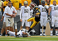 September 17, 2011: Iowa Hawkeyes wide receiver Marvin McNutt (7) is tripped up by Pittsburgh Panthers defensive back Jarred Holley (18) during the first half of the game between the Iowa Hawkeyes and the Pittsburgh Panthers at Kinnick Stadium in Iowa City, Iowa on Saturday, September 17, 2011. Iowa defeated Pittsburgh 31-27.