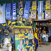 Boca Juniors and Argentina football merchandise on sale outside the famous Boca Juniors football stadium, La Bombonera, in La Boca region of Buenos Aires, Argentina, 25th June 2010. Photo Tim Clayton..