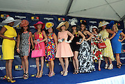 Contestants show off their style during the Longines Most Elegant Woman at the Preakness contest, Saturday, May 16, 2015, at Pimlico Race Course in Baltimore, Md. Longines, the Swiss watch manufacturer known for its elegant timepieces, is the Official Watch and Timekeeper of the 140th annual Preakness Stakes and the Triple Crown. (Photo by Diane Bondareff/Invision for Longines/AP Images)