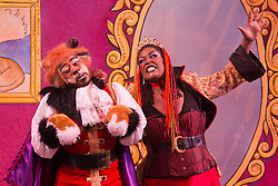 """© Licensed to London News Pictures. 27/11/2013. London, England. Kat B as Puss in Boots and Sharon D Clarke as Queen Talulah the Hoo Ha. The Christmas Panto """"Puss in Boots"""" opens at the Hackney Empire, London. With Kat B in the title role, written and directed by Susie McKenna. Photo credit: Bettina Strenske/LNP"""