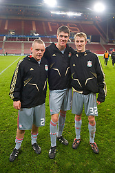 EINDHOVEN, THE NETHERLANDS - Tuesday, December 9, 2008: Liverpool's European debutantes L-R Jay Spearing, Martin Kelly and Stephen Darby after helping the Reds to a 3-1 victory over PSV Eindhoven during the final UEFA Champions League Group D match at the Philips Stadium. (Photo by David Rawcliffe/Propaganda)