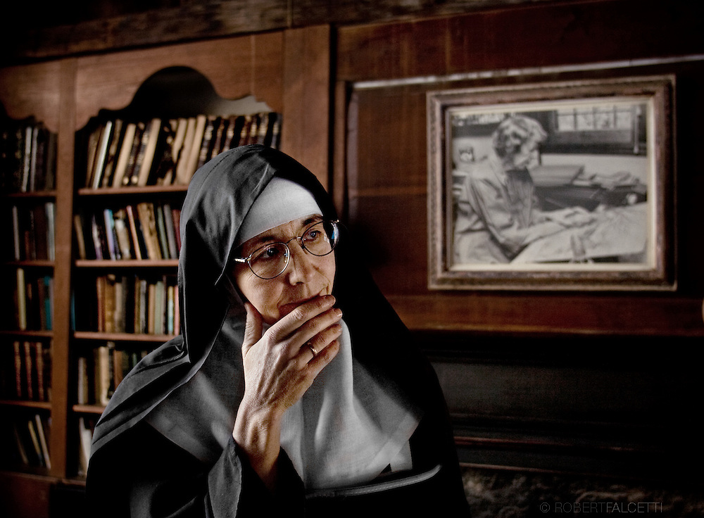 "Mother Margaret Georgina Patton is seen inside Sheepfold, the home and studio of artist Lauren Ford, pictured on wall. Ford won the Caldecott Honor Award in 1940 for her children's book ""The Ageless Story: With Its Antiphons"". The artist hosted the founding members of the abbey at Sheepfold and left the estate to the Abbey of Regina Laudis. .(Photo by Robert Falcetti)"