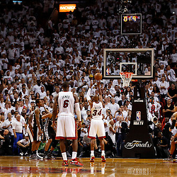 Jun 18, 2013; Miami, FL, USA; Miami Heat shooting guard Ray Allen (34) makes a free throw with 1.9 seconds left in overtime of game six in the 2013 NBA Finals against the San Antonio Spurs at American Airlines Arena. The Heat won 103-100 in overtime. Mandatory Credit: Derick E. Hingle-USA TODAY Sports