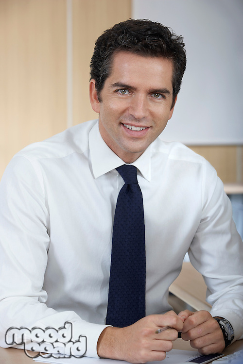 Man wearing shirt and tie in office portrait