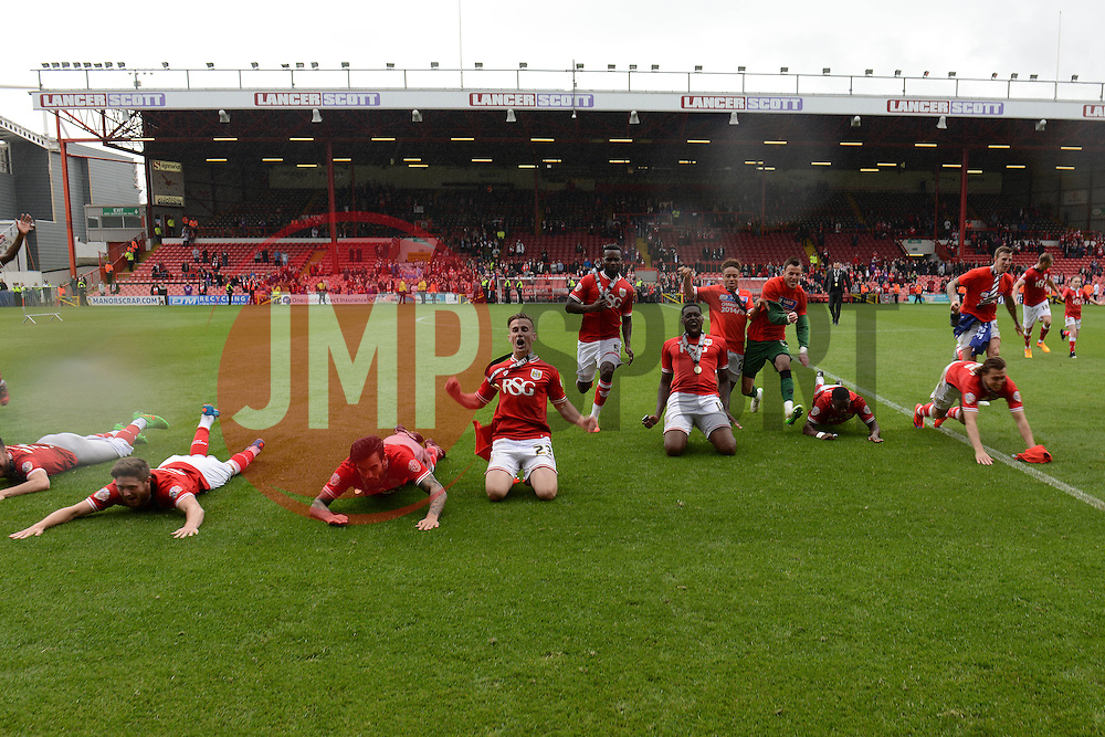 Bristol City slide on the pitch to celebrate being crowned champions of League One  - Photo mandatory by-line: Dougie Allward/JMP - Mobile: 07966 386802 - 03/05/2015 - SPORT - Football - Bristol - Ashton Gate - Bristol City v Walsall - Sky Bet League One