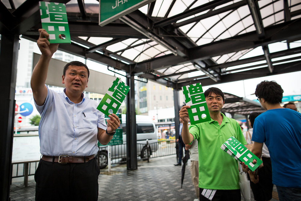 TOKYO, JAPAN - JULY 21 : Leaflets of candidate Hiroya Masuda being distributed in the street during a Tokyo Gubernatorial Election 2016 campaign rally at Kanamachi Station, Tokyo, Japan on Thursday, July 21, 2016. Tokyo residents will vote on July 31 for a new Tokyo Governor who will deal with issues related to hosting the Summer Tokyo Olympics and Paralympics in 2020. (Photo: Richard Atrero de Guzman/NUR Photo)