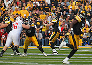 October 23 2010: Iowa Hawkeyes quarterback Ricky Stanzi (12) eyes a receiver during the first half of the NCAA football game between the Wisconsin Badgers and the Iowa Hawkeyes at Kinnick Stadium in Iowa City, Iowa on Saturday October 23, 2010. Wisconsin defeated Iowa 31-30.