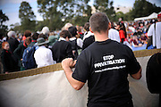 Supporter wearing a shirt advertising opposition to privatisation of prisons and support of the Deaths in Custody Royal Commission recommendations. National Sorry Day, Perth, Western Australia