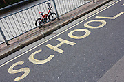 A young child's bike is locked at a primary school's railings in south London.