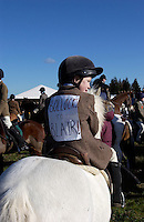Fox Hunting.Hampshire, England, February 19th, 2005 - Vale of Aylesbury with Garth and south hunt, a young fox hunting fan, wearing a coat with a massage