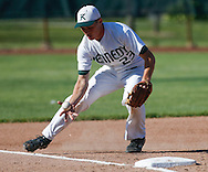 Kennedy third baseman Bryce Church fields a hit by Logan Sims of Iowa City West in the top of the third inning in the first game of a double header at Cedar Rapids Kennedy High School on Friday, June 17, 2016. West won the first game 7-0. (Rebecca F. Miller/The Gazette)