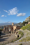 Greek Theatre, built 3rd century BC, in Taormina, Messina, Sicily, Italy. In the distance is Mt Etna. Although originally and typically Greek, used for theatre and music performances, the theatre was remodelled in the 2nd century AD by the Romans and used for games and gladiatorial contests. Picture by Manuel Cohen