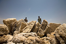 Nomads from the Afar tribe in Ethiopia work the salt flats in Dallol