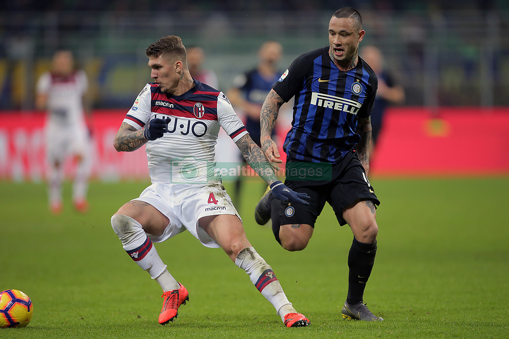 February 3, 2019 - Milan, Milan, Italy - Lyanco #4 of Bologna FC competes for the ball with Radja Nainggolan #14 of FC Internazionale Milano during the serie A match between FC Internazionale and Bologna FC at Stadio Giuseppe Meazza on February 3, 2019 in Milan, Italy. (Credit Image: © Giuseppe Cottini/NurPhoto via ZUMA Press)
