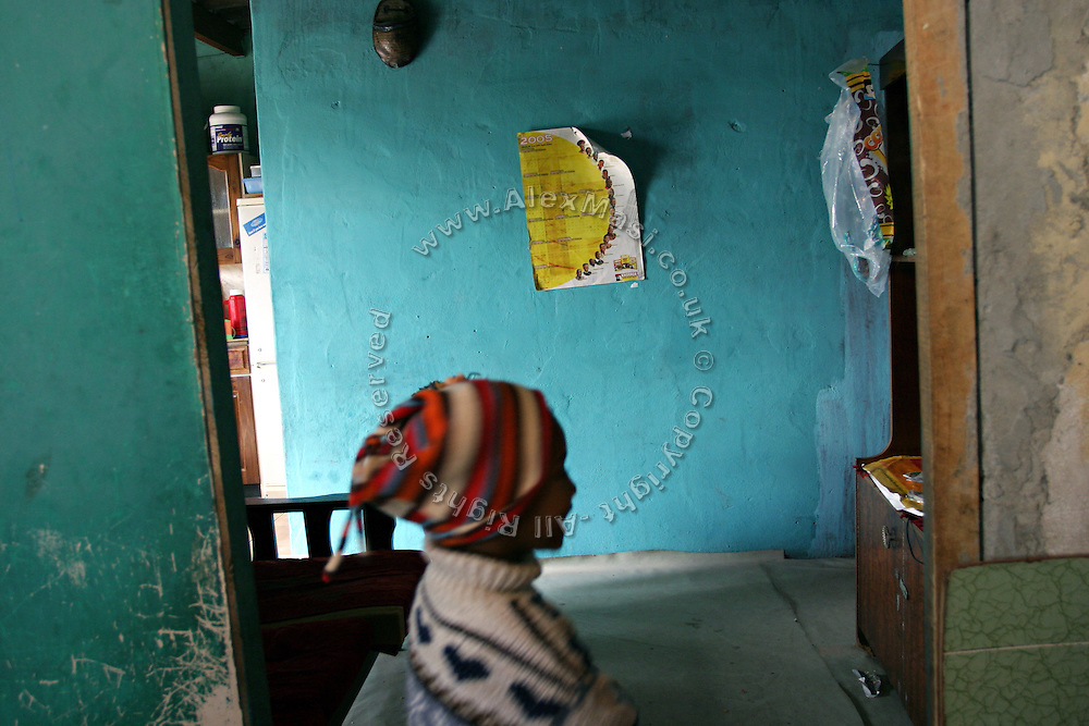 A child is walking inside a creche in Khayelitsha township in Cape Town, where over a million people live in the extreme poverty.