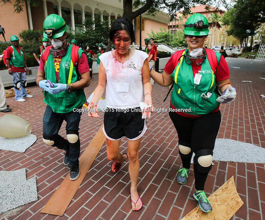 A victim is evacuated by rescuers during the annual Great California ShakeOut earthquake drill at Southern California University (USC) in Los Angeles on October 15, 2015. About 10.4 million Californian's registered to take part in the annual drill that asks participants to 'drop'' to the ground, take 'cover'' under a desk, table or other sturdy surface, and 'hold on'' for 60 seconds, as if a major earthquake were occurring.(Photo by Ringo Chiu/PHOTOFORMULA.com)