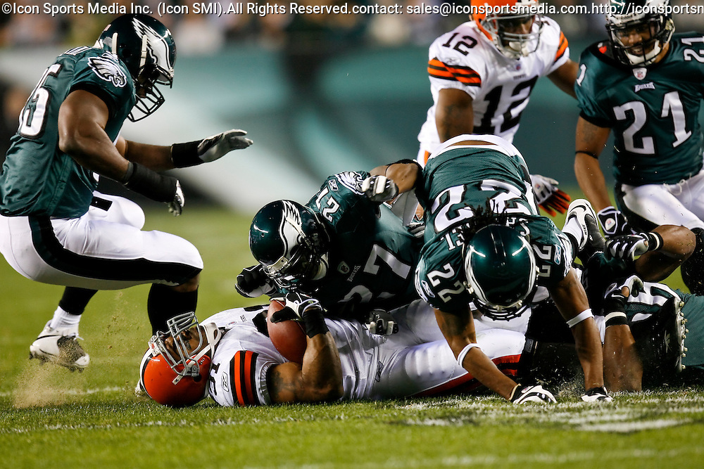 15 Dec 2008: Cleveland Browns running back Jamal Lewis #31 is taken down by Philadelphia Eagles safety Quintin Mikell #27 and cornerback Asante Samuel #22 during the game against the Philadelphia Eagles on December 15th, 2008. The Eagles won 30-10 at Lincoln Financial Field in Philadelphia, Pennsylvania